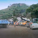Trucks lined up to load stones from the site