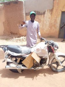One of the motorcycle beneficiaries