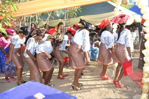 Females in Ase-Ebi dress dancing with the bride